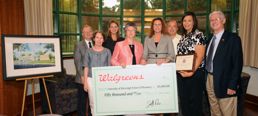School of Pharmacy administrators accept a $50,000 donation from Walgreens to benefit the Pharmacy Practice Building on the UMMC campus. Pictured are: Back row: Charlie Hufford (left), Leigh Ann Ross, Marvin Wilson Front row: Rachel Robinson (left), Dean Barbara Wells, Walgreens representatives Tonya Shackleford (BSPH '94) and Kimsey Cooper (BSPH '94) and Dewey Garner.