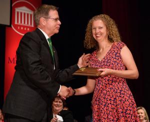 Kristie Willett is presented an award from Chancellor Jeff Vitter