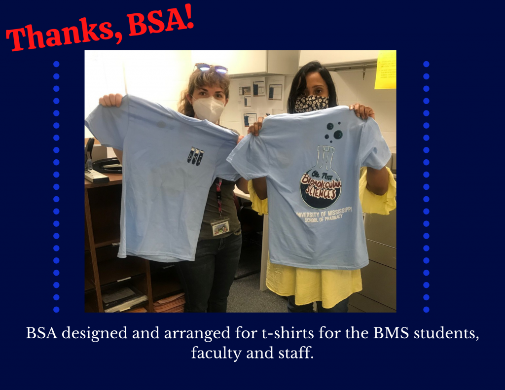 Picture of 2 people holding t shirts, thanking the BSA organization for designing and arranging t shirts