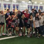 Students throw the fins up symbol during a tour of the indoor football facility.