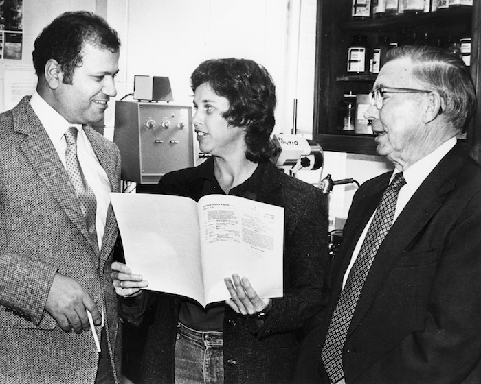 Dr. Mahmoud ElSohly (left) talks with colleagues.