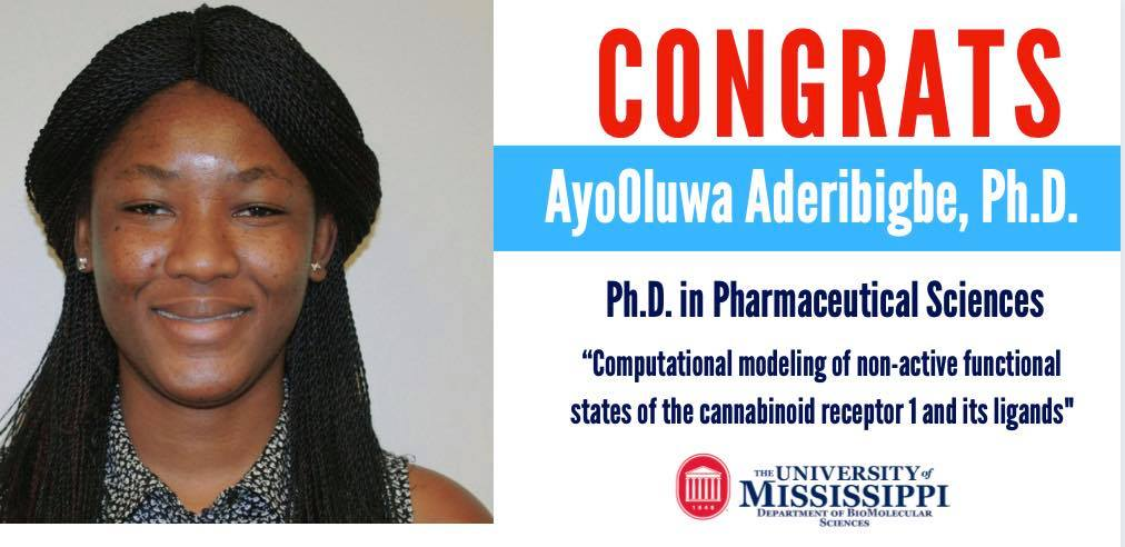 An announcement congratulating AyoOluwa Aberbigbe on a succesful Ph.D. Defense in Pharmaceutical Sciences. A picture of student smiling.