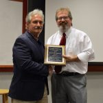 Steve Blackwell accepts award from John Bentley