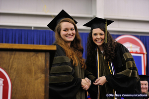 Miranda Jordan (left) and Laura Luther were inducted into the school's Hall of Fame during commencement ceremonies.