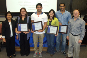 Student winners of the poster competition receive their awards. From left to right: Agnes M. Rimando, chair of the poster awards committee; Pranapda Aumsuwan, 3rd place; Praneeth Reddy, 3rd place; Monica Gole, 2nd place; Krishna Nagalla, 1st place; and James Cizdziel, president of the Ole Miss Section of ACS