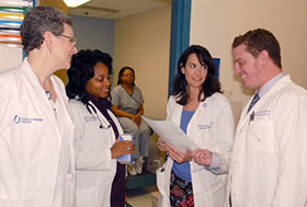 Daniel Riche (far right) advises fellow cardiometabolic clinic team members about the best medications for patients under their care.