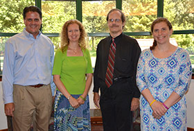 Stephen J. Cutler (left), Kristine L. Willett, Gary D. Theilman and Tracy A. Brooks