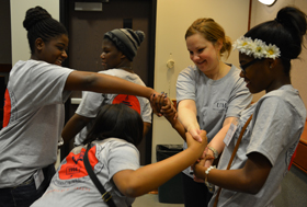 Chelsea Bennett (second from right), assistant dean for student services, participates in a team-building exercise with students from Jackson high schools.