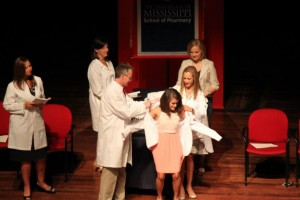 Stephanie Sollis receiving her white coat.
