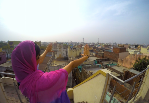 A local Oxford resident takes in the view from the rooftop in Amroha, India.