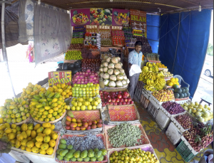 A fruit stand that sits next to one of the highways in India.