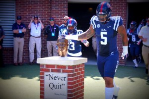 Robert Nkemdiche paying tribute to Chucky Mullins before a game.