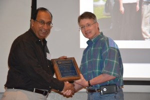 Babu Tekwani (left) receives the Cumberland Pharmaceuticals Inc. Faculty Research Award from Dean David D. Allen.