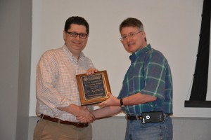 Jay Pitcock (left) receives the Faculty Instructional Innovation Award from Dean David D. Allen.