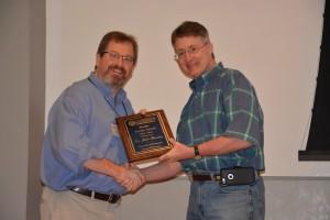 John Bentley (left) receives the Faculty Service Award from Dean David D. Allen.