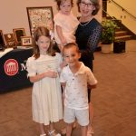 Rachel Robinson, retiring assistant clinical professor of pharmacy practice, and her grandchildren at her retirement ceremony in June 2017.