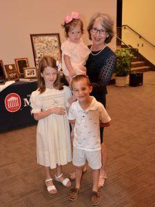 Rachel Robinson, retiring assistant clinical professor of pharmacy practice, and her grandchildren at her retirement ceremony in June 2017.