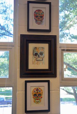 Jamie Stewart's paintings in his office