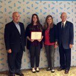 Alex Gochenauer accepts award