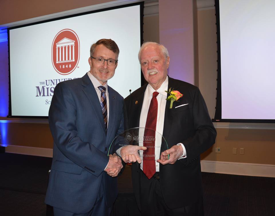 Dean David D. Allen presents Percy Malone with the Alumnus of the Year award.