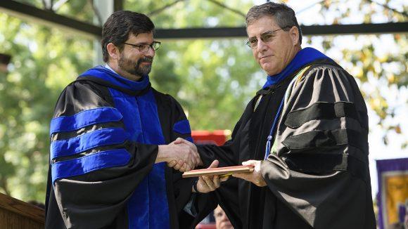 Marc Slattery receives award from Josh Gladden