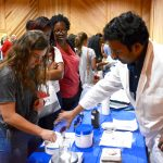 Pharmacy showcase attendee compounding at event.