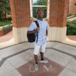 Male student Brandon Ashmore poses with backpack on shoulder