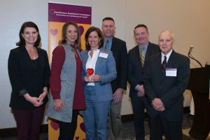 Leigh Ann Ross and Lauren Bloodworth with four AstraZeneca Health Foundation representatives