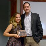 John Rimoldi presents Maria Alvim Gaston with an award plaque
