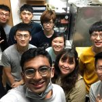 Sanjanwala poses for a selfie with a group of students in lab