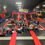 Group photo of students on indoor trampolines