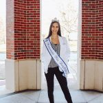 Kasey Pearson standing in her pharmacy white coat and pageant crown and sash