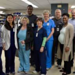 Group picture of pharmacists and techs in a hospital pharmacy
