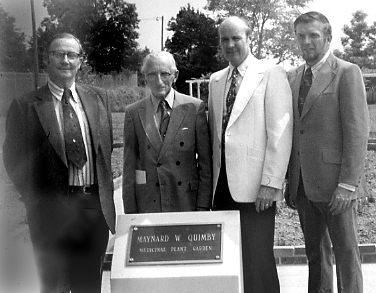 The dedication ceremony at the Medicinal Plant Garden in 1976 (Left to right: Dr. Charles E. Noyes, Associate Vice Chancellor, Professor of English; Dr. Maynard W. Quimby, Emeritus Professor of Pharmacognosy; Dr. Wallace L. Guess, Dean of School of Pharmacy and Dr. Norman J. Doorenbos, Chairman and Professor of Pharmacognosy).