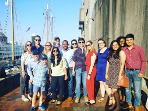 Group picture beside boat harbor in Boston
