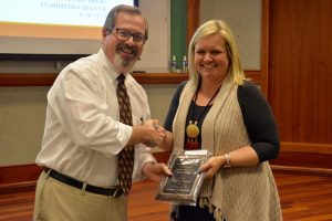 Ashley Crumby receives her award from John Bentley