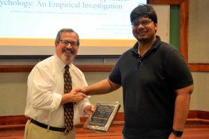 Kaustuv Bhattacharya receives his award from John Bentley