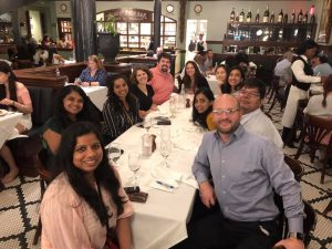 Group photo sitting down at table in restaurant