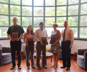 Robert Doerksen, Katie Barber, Ikhlas Khan and Donna West-Strum eceive awards from the school.