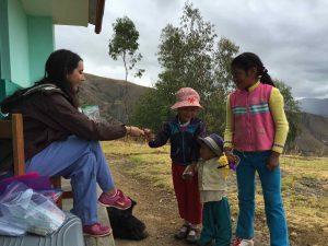 Peruvian children wait for lollipops from PY4 Caroline Bobinger