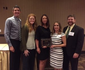 Left to right: Josh Fleming, Laurie Fleming, Leigh Ann Ross and Courtney Davis accept MSHP awards on behalf of the University of Mississippi School of Pharmacy, presented by Todd Dear.