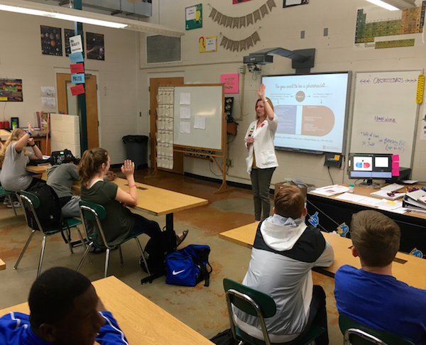 Pharmacist Lori Horn speaks to a middle school science class about pharmacy.