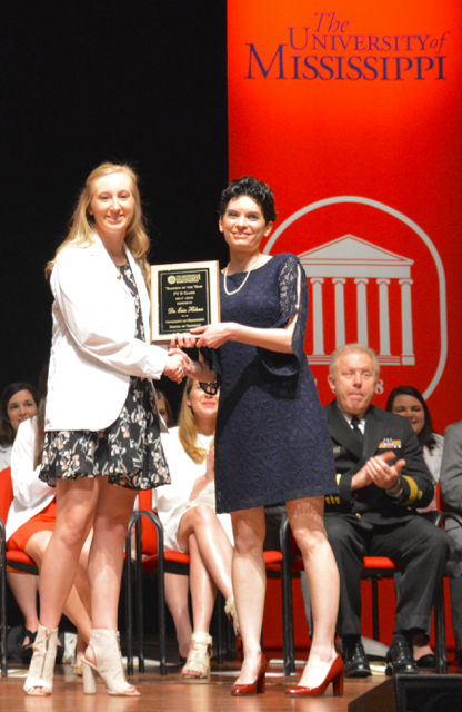 Erin Holmes wins the Ole Miss School of Pharmacy's Teacher of the Year award.