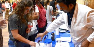 Students compounding at a pharmacy showcase event.