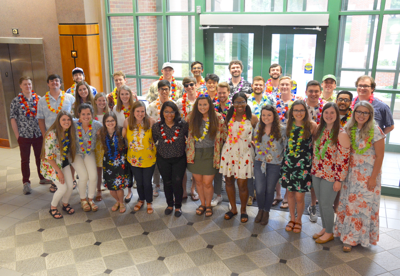 Group of students dressed in Hawaiian clothes