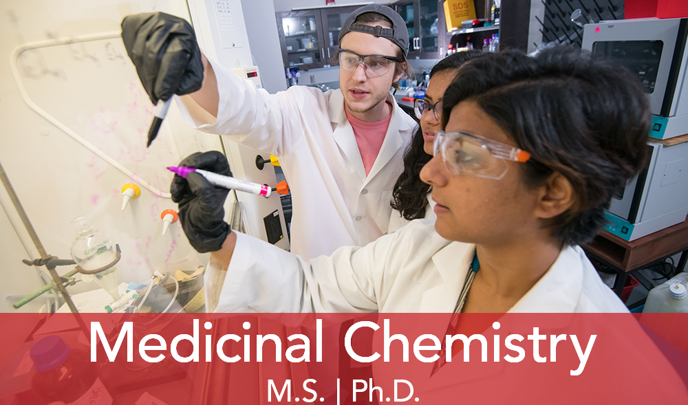 Two students look at formulations with a female professor in the lab.