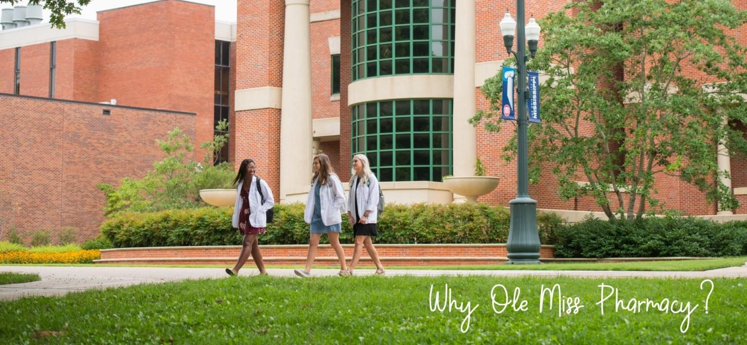 Three students walking and talking