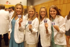 Students smiling with patches