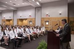 Dean Allen speaks at the podium